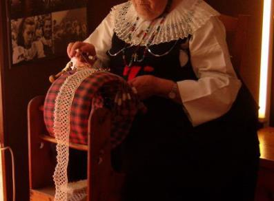 Craftswoman in typical Cogne dress